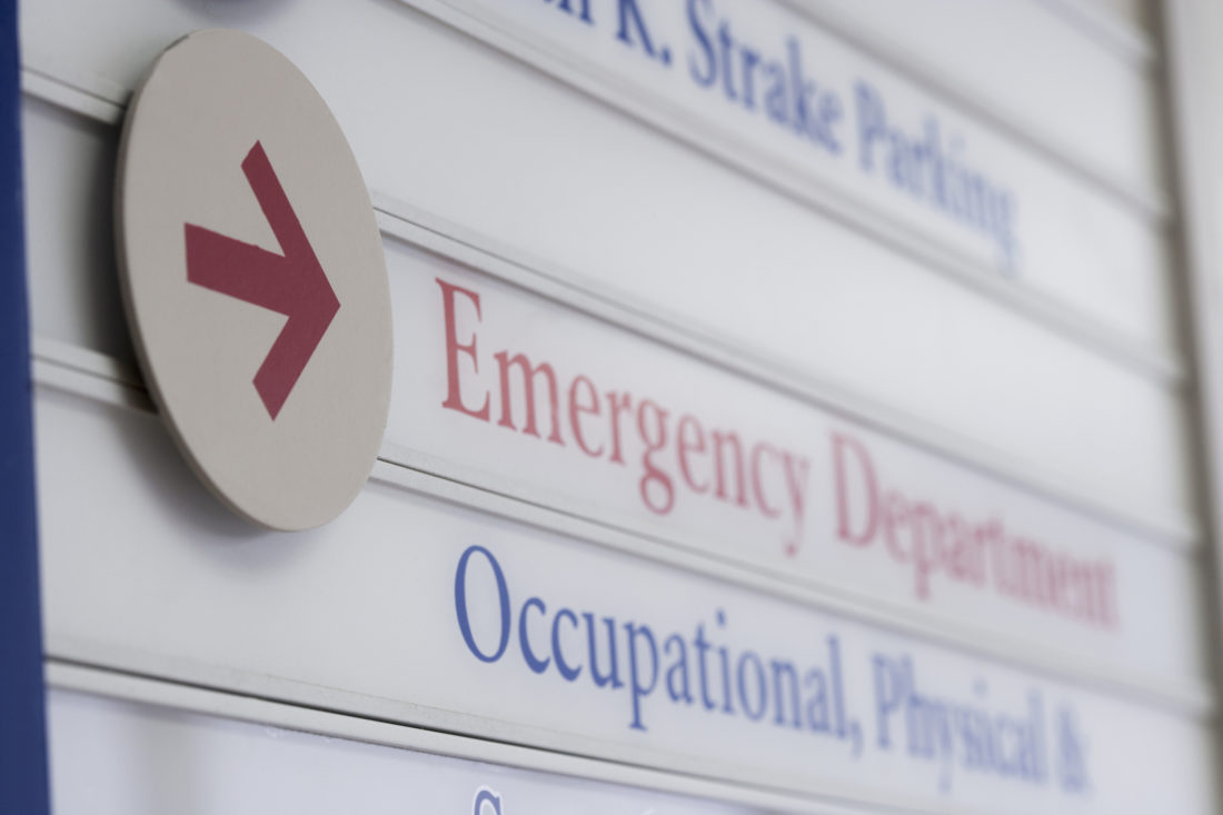 Close up of sign for emergency department in hospital