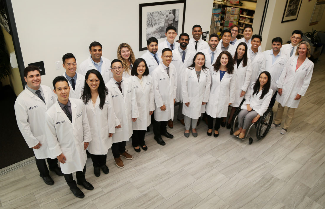 professional photo of a group of male and female residents at a hospital